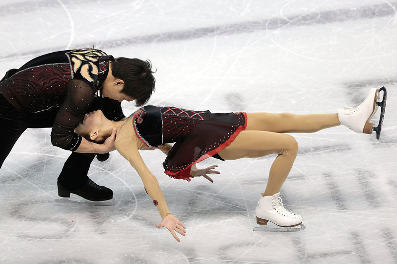 . Cheng Peng And Hao Zhang of China skate their short program in the pairs competition at the 2013 World Figure Skating Championships in London, Ontario, March 13, 2013.  GEOFF ROBINS/AFP/Getty Images