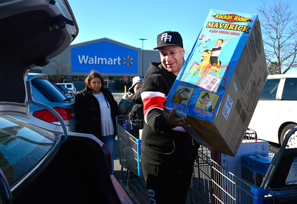 11/23/2018 Mike Orazzi | Staff David Rivera while unloading items he bought at the Bristol Walmart on Black Friday.