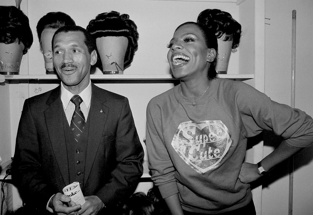 """. Sheryl Lee Ralph of he Broadway show \""""Dreamgirls\"""" is visited backstage by Major Charles F. Bolden, the first black astronaut, in New York, Feb. 16, 1983. (AP Photo/Nancy Kaye)"""
