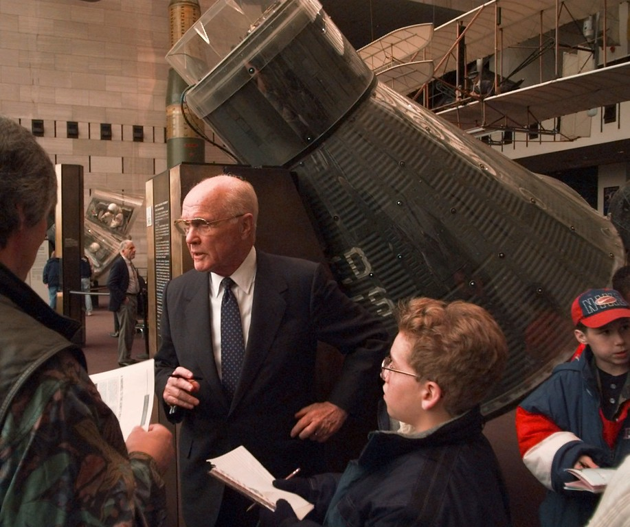 . Sen. John Glenn, D-Ohio stands next to his Mercury Friendship 7 spacecraft at the Smithsonian\'s Air and Space Museum in Washington Monday Feb. 10, 1997.  On Feb. 20,  1997, Glenn will mark the 35th anniversary of becoming the first American in oribit. (AP Photo/Ron Edmonds)