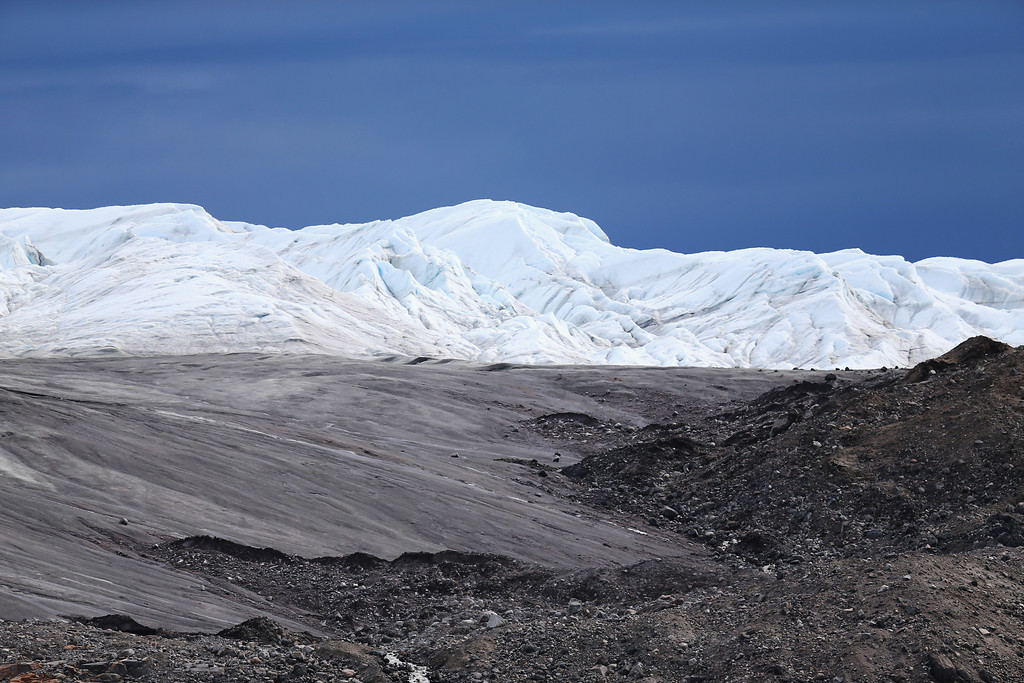 . A glacier is seen behind recently uncovered earth on July 12, 2013 in Kangerlussuaq, Greenland.   (Photo by Joe Raedle/Getty Images)