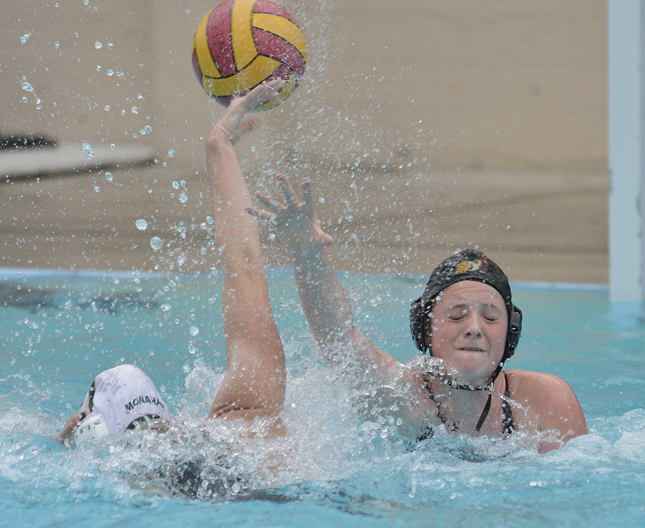 . LONG BEACH, CALIF. USA -- Wilson\'s Alexis Angermund (2) works to defend against a shot by Poly\'s Aubrie Monahan (21) in Long Beach, Calif., on February 7, 2013. Wilson defeated Poly, 6 to 5, to win the Moore League. Photo by Jeff Gritchen / Los Angeles Newspaper Group