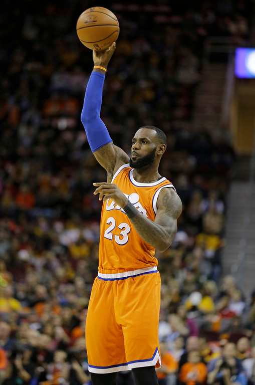 . Cleveland Cavaliers\' LeBron James passes against the Miami Heat in the first half of an NBA basketball game Friday, Dec. 9, 2016, in Cleveland. (AP Photo/Tony Dejak)