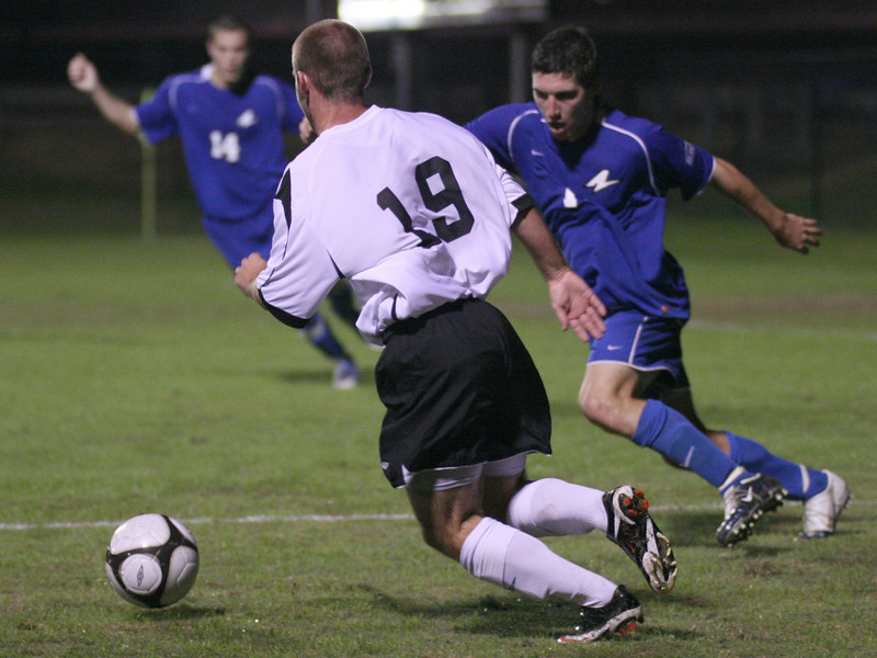 Midfielder Richard Wall (19) battles an opponent in the mens' soccer 2-1 victory over UNC Asheville Wednesday night.