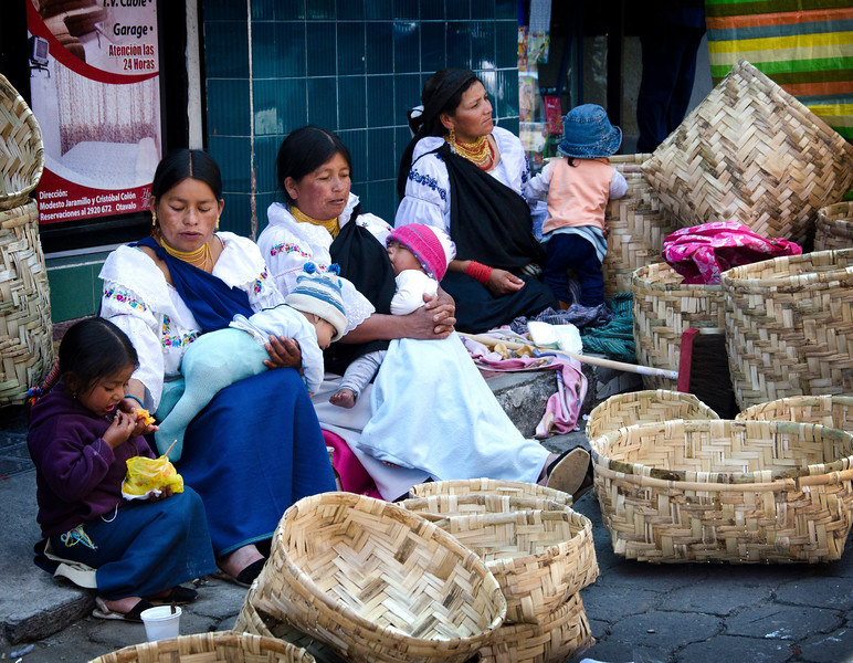 Otavalo women with their babies and baskets at the Mercado Artesanal- the Saturday market.
