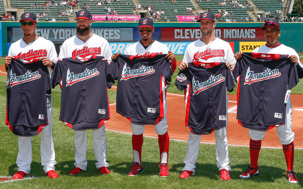 . From left, Cleveland Indians\' Michael Brantley, Corey Kluber, Francisco Lindor, Yan Gomes and Jose Ramirez hold their All-Star jerseys before playing the New York Yankees in a baseball game, Sunday, July 15, 2018, in Cleveland. Trevor Bauer was warming up for the game and is not pictured. (AP Photo/Ron Schwane)