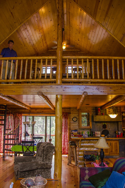 View of the kitchen, dining and loft from the living room. That's Ger up in the loft. He made it up the  spiral stairs and so can you!