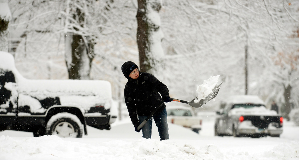 . Work slowly when doing outside chores. Pictured here, Kari Brown shovels nearly a foot of heavy snow from her driveway in front of her home on Reynolds Road in Mentor-on-the-Lake, Nov. 13, 2014. (News-Herald file)