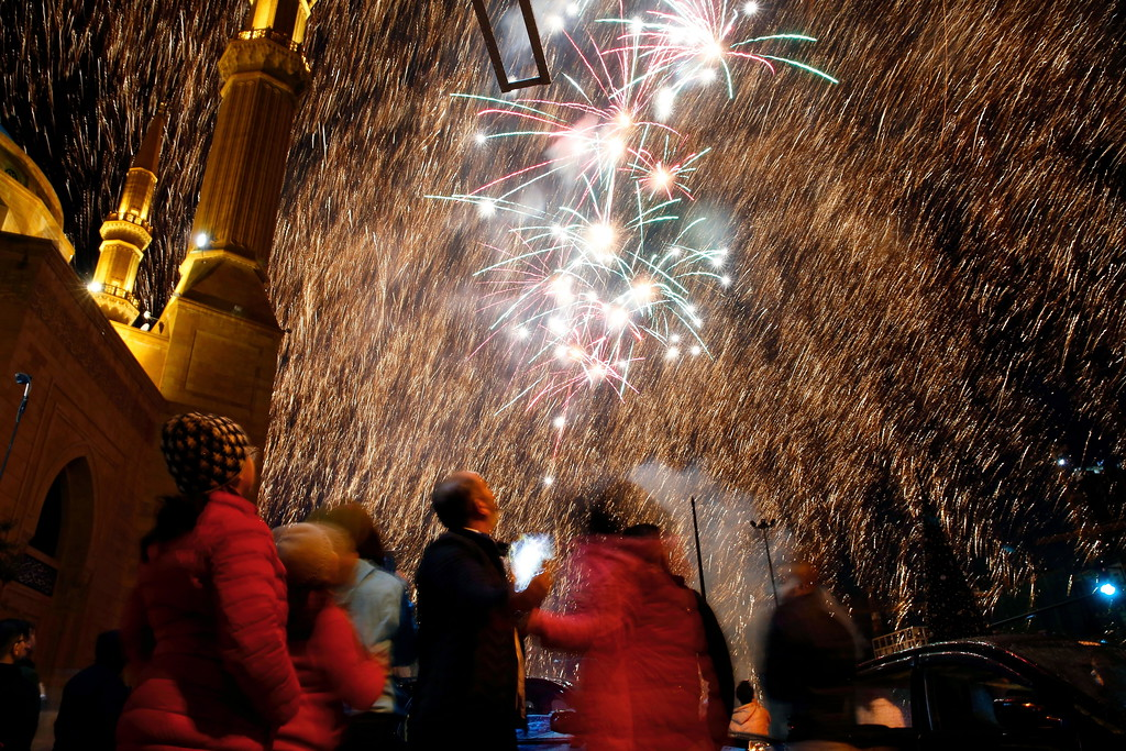 . Lebanese watch a firework display during New Year\'s celebrations in downtown Beirut, Lebanon, Monday, Jan. 1, 2018. (AP Photo/Bilal Hussein)