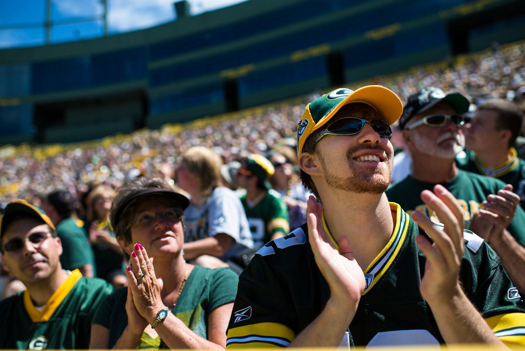 . Josh Fuhur, right, listens to Packers President Mark Murphy as shareholders take part in the annual meeting at Lambeau Field. (AP Photo/The Green Bay Press-Gazette, Lukas Keapproth)