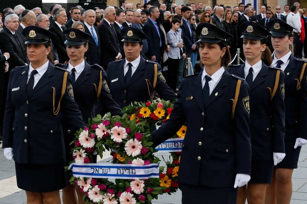 . An honor guard carries wreaths in front of the coffin of former Israeli prime minister Ariel Sharon during the state memorial service at the Knesset (the Israeli Parliament) in Jerusalem on January 13, 2014. Israel paid homage to Ariel Sharon at a memorial service honouring one of its most skilled but controversial leaders who was hailed internationally for his dedication to the Jewish state. (GALI TIBBON/AFP/Getty Images)