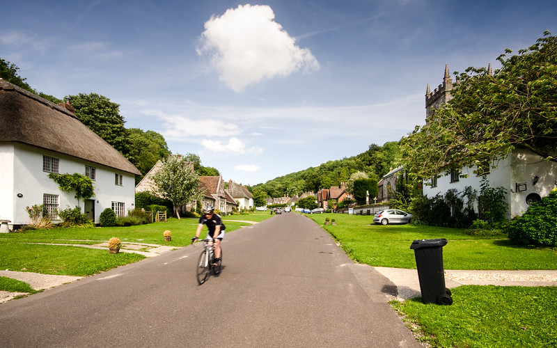 Cyclist in Milton Abbas village