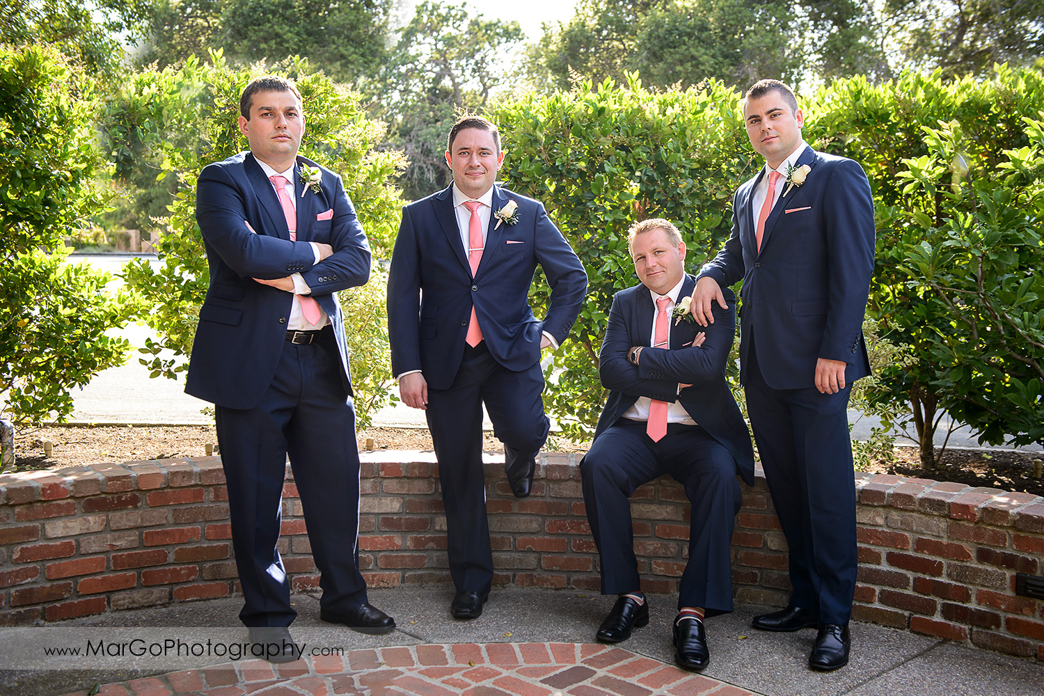 portrait of groom and groomsmen in blue suit and pink tie at Saratoga Foothill Club