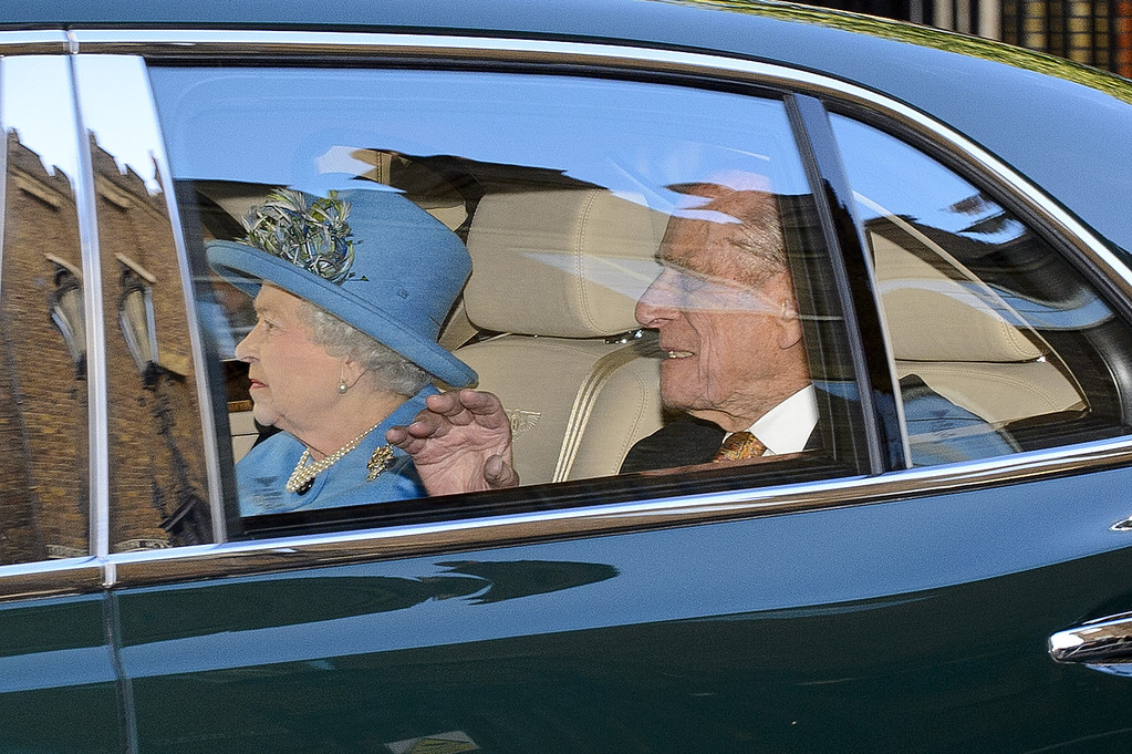 . Queen Elizabeth II and Prince Philip, Duke of Edinburgh arrive to attend the christening of HRH Prince George Of Cambridge at St James\'s Palace on October 23, 2013 in London, England.  (Photo by Ben A. Pruchnie/Getty Images)