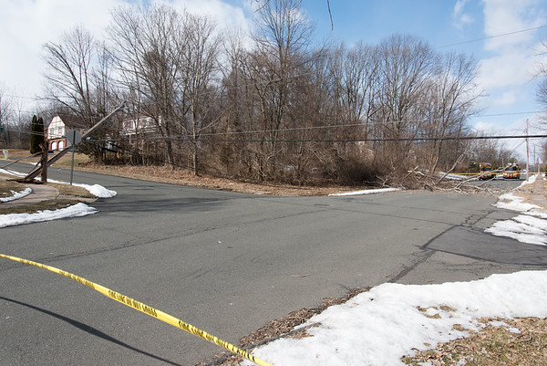 02/25/19 Wesley Bunnell | Staff High winds caused a large tree to fall near the intersection of Farmstead Rd and Hightower Rd in Southington pulling down electrical wires and snapping an electrical pole at the base. The pole visible on the left while the tree lies across Farmstead Rd on the right.