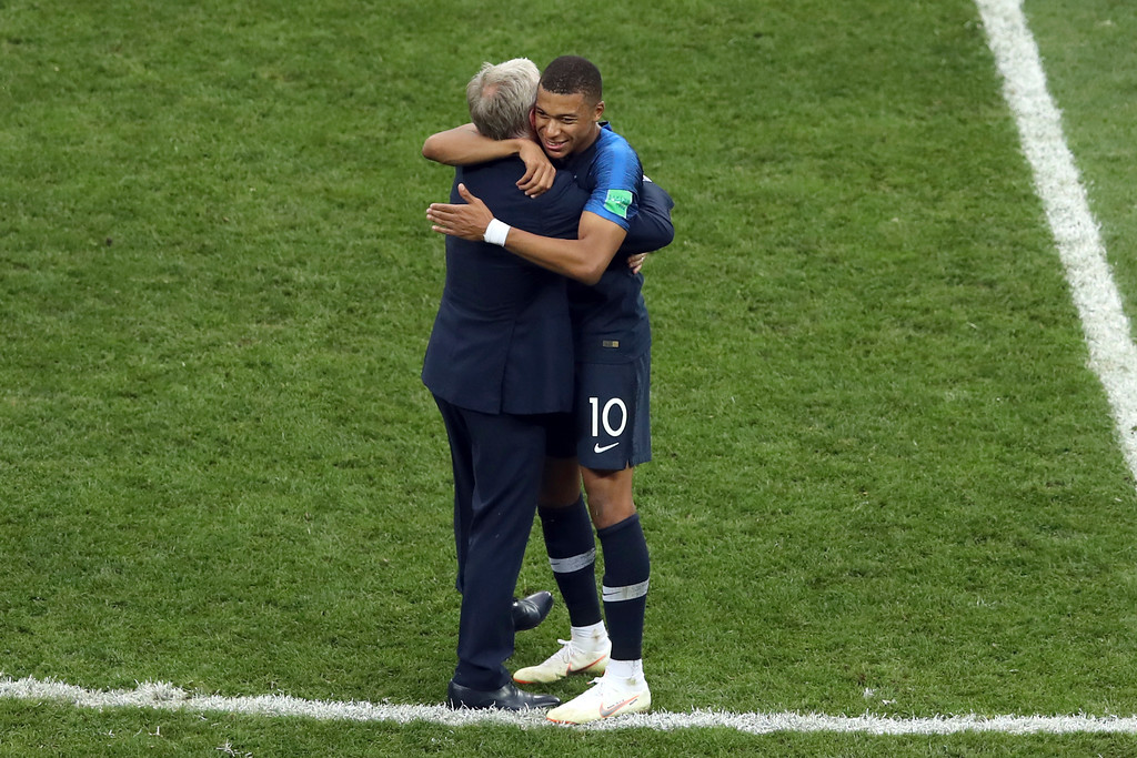 . France\'s Kylian Mbappe celebrates with France head coach Didier Deschamps at the end of the final match between France and Croatia at the 2018 soccer World Cup in the Luzhniki Stadium in Moscow, Russia, Sunday, July 15, 2018. (AP Photo/Thanassis Stavrakis)