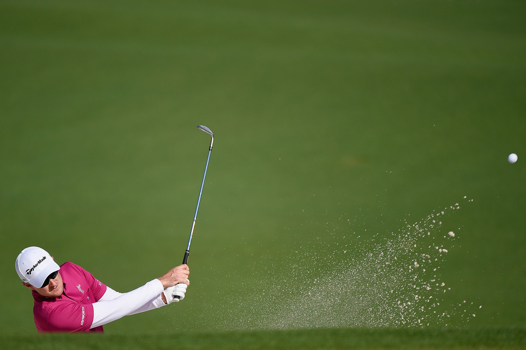 . Justin Rose of England plays a shot during a practice round prior to the start of the 2014 Masters Tournament at Augusta National Golf Club on April 9, 2014 in Augusta, Georgia.  (Photo by Harry How/Getty Images)