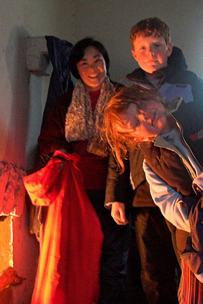 Cynleen, Lachlan and Eliza, keeping warm in the hut