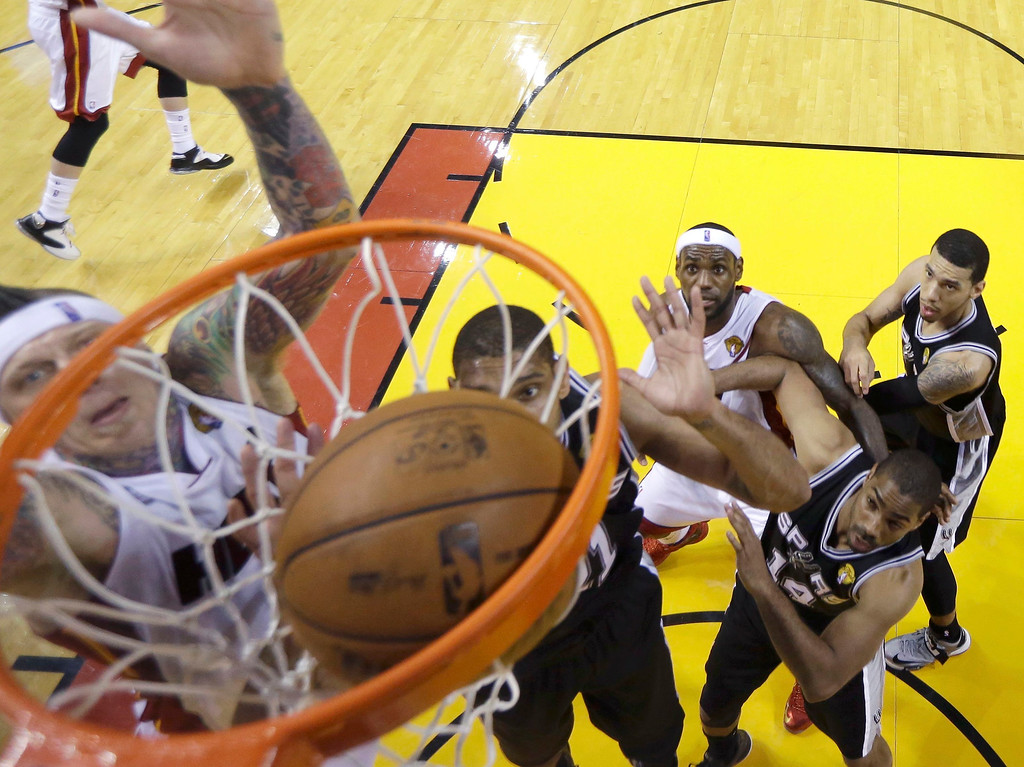 . Miami Heat small forward LeBron James (6) is blocked out by San Antonio Spurs\' Gary Neal (14) and Danny Green (R) as Chris Andersen (L) scores on Tim Duncan (21) during Game 7 of their NBA Finals basketball playoff in Miami, Florida June 20, 2013. REUTERS/Lynne Sladky/Pool