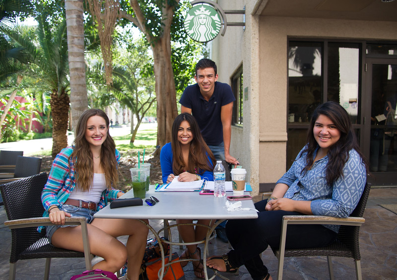 Laura Mansivais(left), Valeria De Luna, Larissa Quinonez and Farid Ganem pause for a quick picture during their free time outside Starbucks.