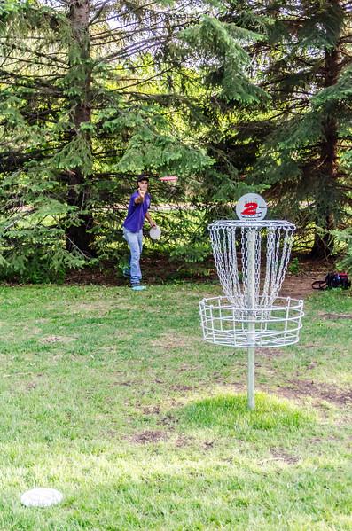 disc golfer - far away