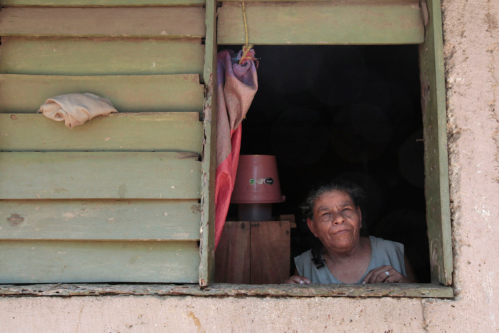 . An indigenous woman looks out from her house at the indigenous community of Monimbo in Masaya City, about 24 km (15 miles) south of Managua, April 9, 2013. Indigenous representatives from Bolivia, Chile, Colombia, Ecuador, Guatemala, Honduras, Mexico, Nicaragua, Panama, Peru and Venezuela will analyze the food security of their peoples during the 13th ordinary session of the Indigenous Parliament of America (PIA) held in the city of Managua.  REUTERS/Oswaldo Rivas