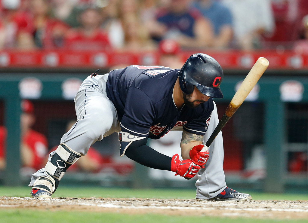 . Cleveland Indians\' Yonder Alonso reacts to a strike out against Cincinnati Reds relief pitcher Amir Garrett (50) during the sixth inning of a baseball game, Monday, Aug. 13, 2018, in Cincinnati. (AP Photo/Gary Landers)