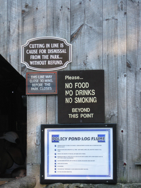 Signs at the Policy Pond Log Flume ride.