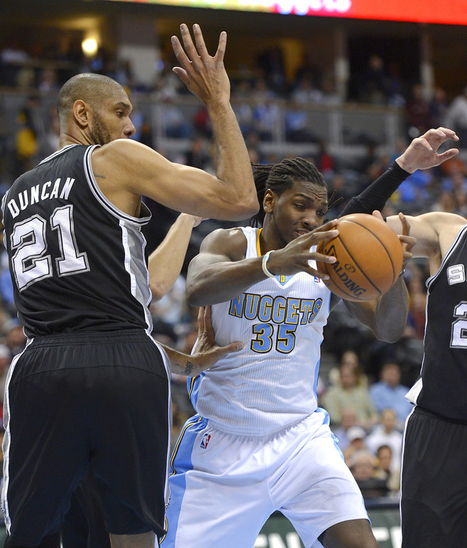 . Denver Nuggets Kenneth Faried (35) losescontrol of the ball as San Antonio Spurs Tim Duncan (21) defends on the play during the third quarter April 10,  2013 at Pepsi Center. (Photo By John Leyba/The Denver Post)