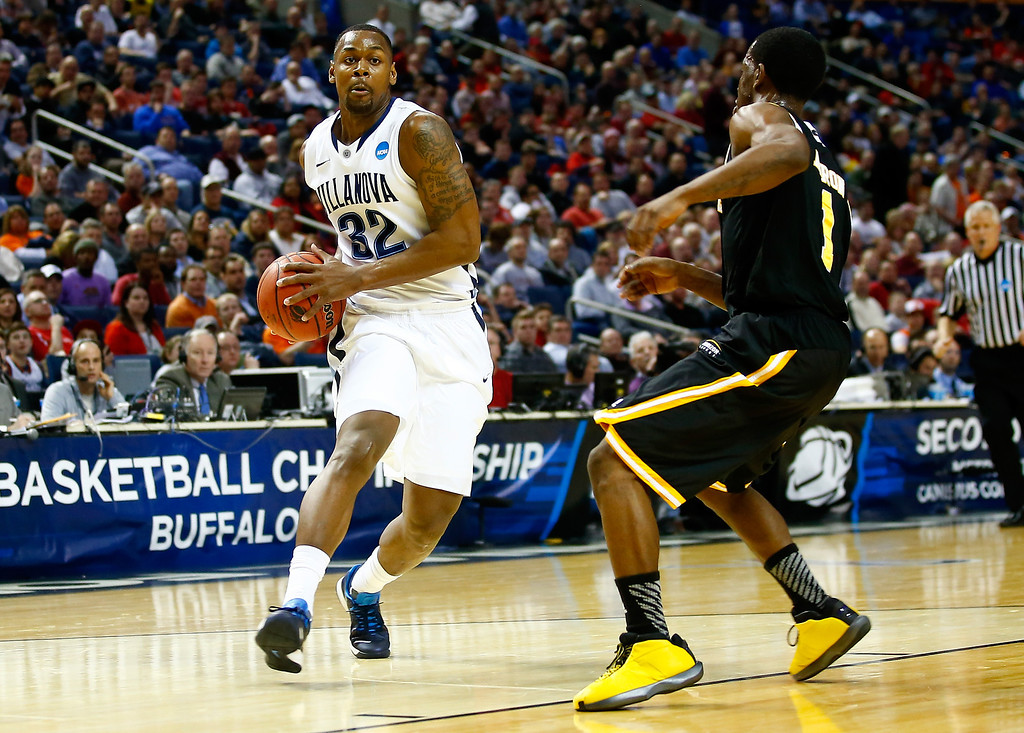 . BUFFALO, NY - MARCH 20: James Bell #32 of the Villanova Wildcats drives to the basket as Jordan Aaron #1 of the Milwaukee Panthers defends during the second round of the 2014 NCAA Men\'s Basketball Tournament at the First Niagara Center on March 20, 2014 in Buffalo, New York.  (Photo by Jared Wickerham/Getty Images)