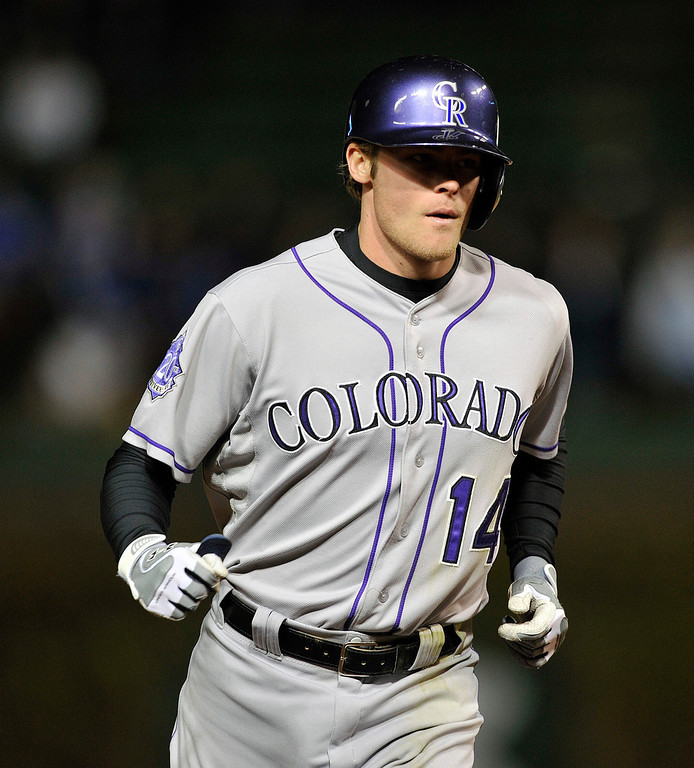 . Colorado Rockies\' Josh Rutledge rounds second after his solo home run against the Chicago Cubs during the ninth inning of a baseball game Monday, May 13, 2013, in Chicago. (AP Photo/Jim Prisching)