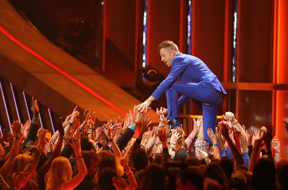 ". Macklemore performs ""Can\'t Hold Us\"" at the MTV Movie Awards in Sony Pictures Studio Lot in Culver City, Calif., on Sunday April 14, 2013. (Photo by Matt Sayles/Invision /AP)"