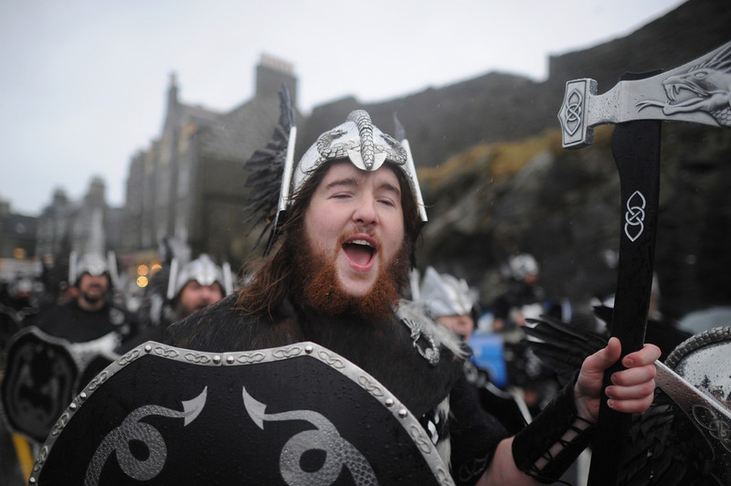 . Locals dressed as Vikings  march through the streets of Lerwick on January 28, 2014, in the Shetland Islands, Scotland. The traditional festival of fire is known as \'Up Helly Aa\'. The spectacular event takes place annually on the last Tuesday of January. The climax of the day comes with participants in full costume hauling a Viking longboat through the streets of Lerwick to the edge of town where up to 1000 people parade and throw their flaming torches into the galley.  (Photo by Jeff J Mitchell/Getty Images)