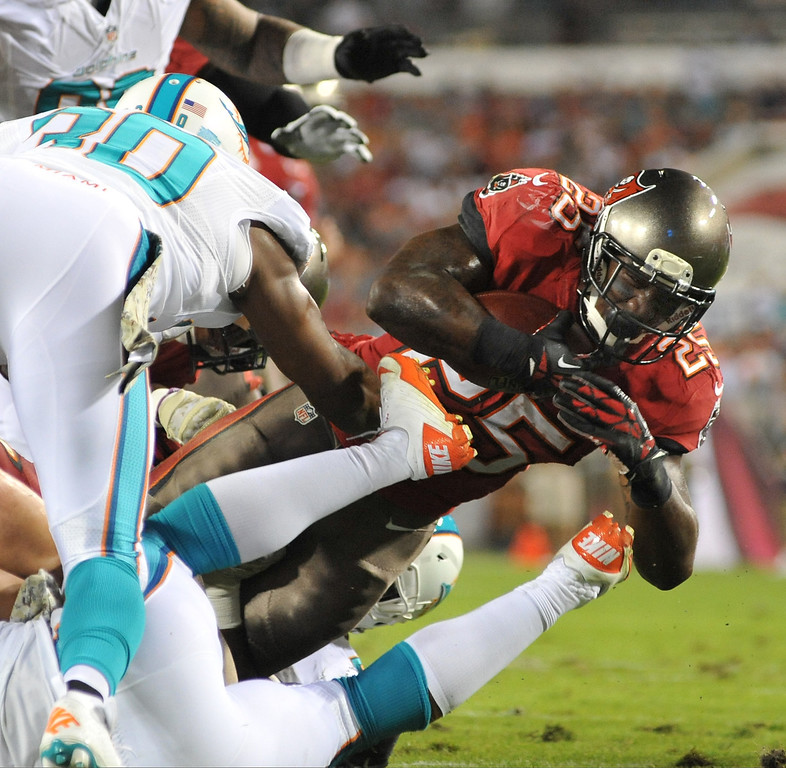 . Running back Mike James #25 of the Tampa Bay Buccaneers dives for a gain in the 1st quarter against the Miami Dolphins November 11, 2013 at Raymond James Stadium in Tampa, Florida. (Photo by Al Messerschmidt/Getty Images)