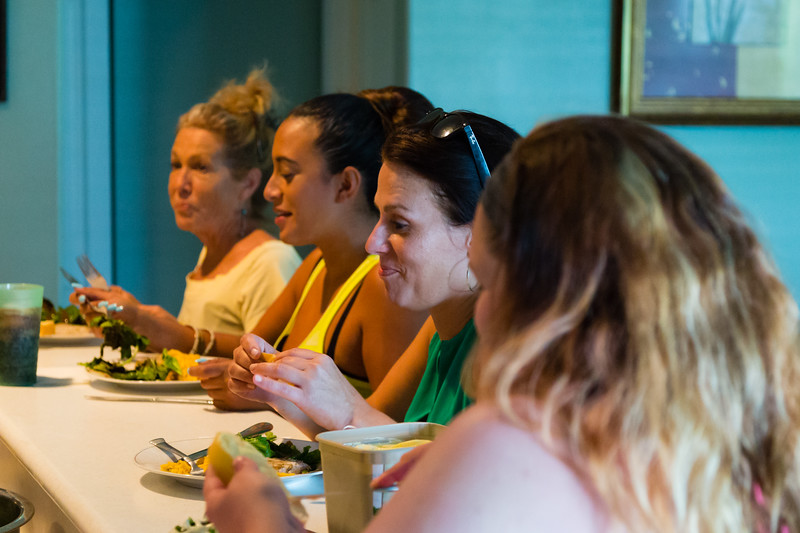 From left to right: 'House mom' Karen Altieri Sharp, residents Mariana Lovecchio, Amy Kilgore and Ashlie Brassbridge eat dinner at the kitchen counter in the All About Recovery younger women's sober home in Loxahatchee, Florida on Wednesday, June 1, 2016. Dinner was prepared by resident Shelby Sparrow.  (Joseph Forzano / The Palm Beach Post)