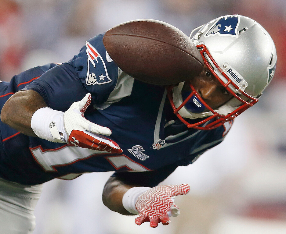 . New England Patriots wide receiver Aaron Dobson can\'t make the reception on a pass from Tom Brady during the second quarter of an NFL football game against the New York Jets on Thursday, Sept. 12, 2013, in Foxborough, Mass. (AP Photo/Elise Amendola)