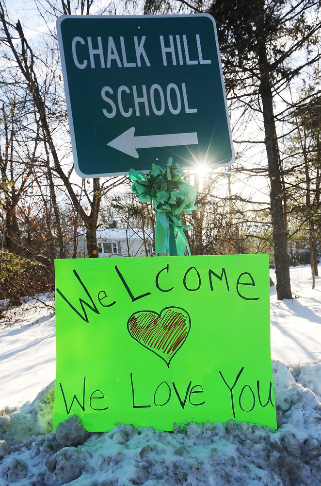 Description of . A sign reads 'Welcome We Love You' beneath a sign pointing to the location of Chalk Hill School, which has been refurbished and renamed Sandy Hook Elementary School on January 3, 2013 in Monroe, Connecticut. Sandy Hook students started their first day of classes in the new building following the mass shooting at the old school in Newtown that left 20 students and six faculty members dead.  (Photo by Mario Tama/Getty Images)