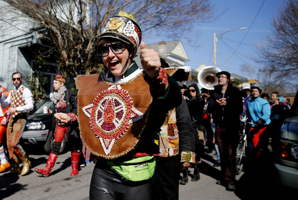 . The sixth annual Red Beans Parade rolled through the Marigny and ended in the Treme with The Treme Brass Band on Lundi Gras, Monday, March 3, 2014, in New Orleans. Participants sported costumes made of various kinds of beans. (AP Photo/NOLA.com The Times-Picayune, Kathleen Flynn)