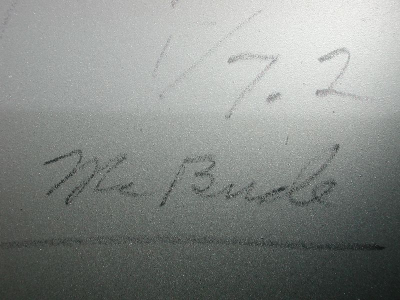 """The pencil writing on the mirror's back reads """" 1/7.2 """" but the name following is not as clear. Perhaps """" Mr. Bude"""" or """" Mr. Burle""""  ??"""