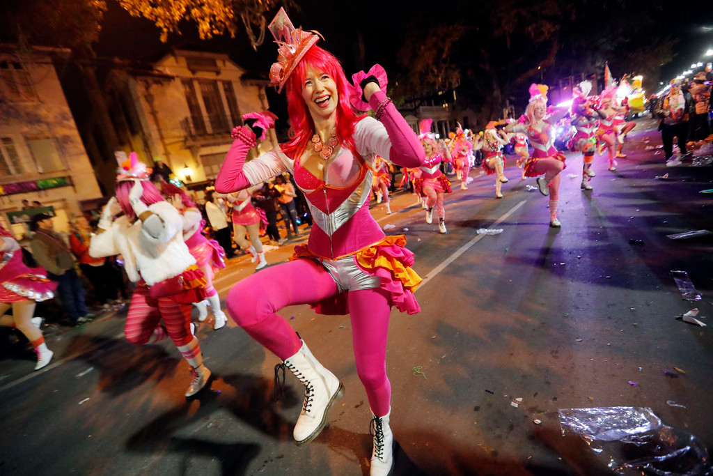 . Members of the Pussyfooters dance at the Krewe of Cleopatra Mardi Gras parade in New Orleans, Friday, Feb. 2, 2018. Mardi Gras season is kicking into high gear with a slew of major parades throughout New Orleans. Although Carnival season officially began Jan. 6, the festivities really kick into high gear the two weekends ahead of Fat Tuesday. This year Fat Tuesday is Feb. 13.(AP Photo/Gerald Herbert)