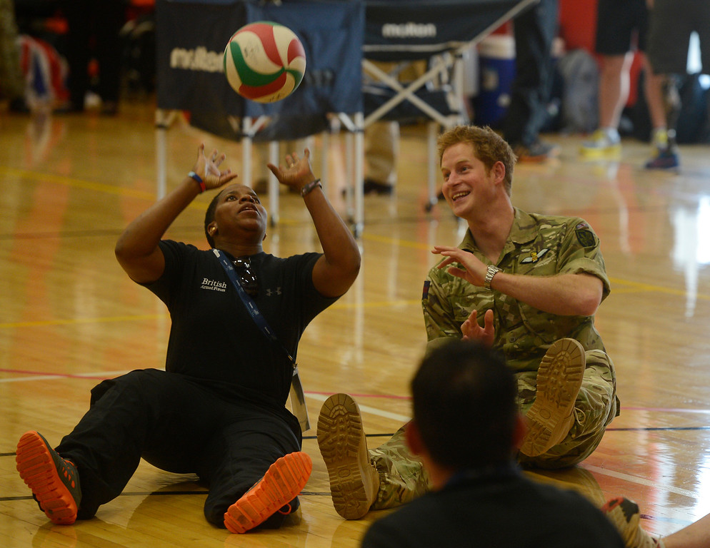 . COLORADO SPRINGS, CO - MAY 11: Britain\'s Prince Harry, right, and British Armed Forces volleyball team member, Maurillia Simpson, left, play a quick game at the United States Olympic Training Center before the opening ceremonies at the 2013 Warrior Games Saturday morning, May 11th, 2013. (Photo By Andy Cross/The Denver Post)