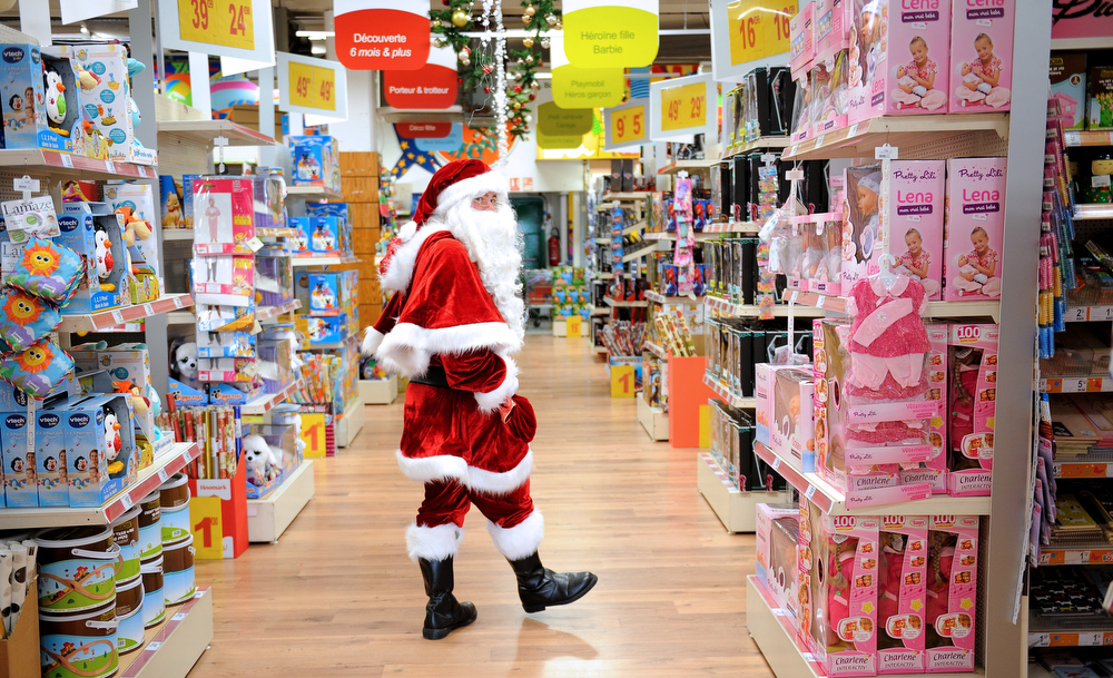 Description of . A Santa Claus walks through a toy store in Lille, northern France, on December 15, 2012.  PHILIPPE HUGUEN/AFP/Getty Images