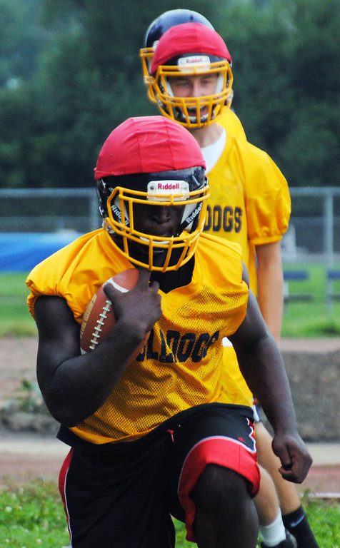 . Jon Behm - The Morning Journal<br> Olmsted Falls running back Devontae Boyd runs a drill during Olmsted Falls\' first day of football practice on July 30.