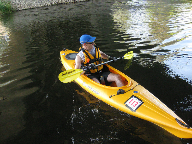 """Nice break under the 116th Street bridge. This picture gives a great view of the true nature of this kayak. Notice my drink resting in the """"beer holder"""". Also, the black thing bolted on to my front right is where the fishing pole holder goes. :-)"""
