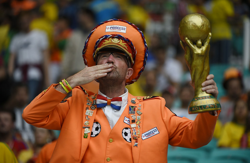 . A Netherlands\' fan holds a replica of the World Cup trophy as he cheers prior to the kick-off of the quarter-final football match between Netherlands and Costa Rica at the Fonte Nova Arena in Salvador during the 2014 FIFA World Cup on July 5, 2014. (ODD ANDERSEN/AFP/Getty Images)