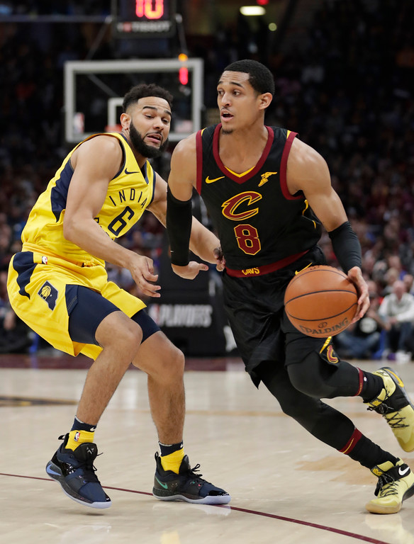 . Cleveland Cavaliers\' Jordan Clarkson (8) drives past Indiana Pacers\' Cory Joseph in the first half of Game 5 of an NBA basketball first-round playoff series, Wednesday, April 25, 2018, in Cleveland. The Cavaliers won 98-95. (AP Photo/Tony Dejak)