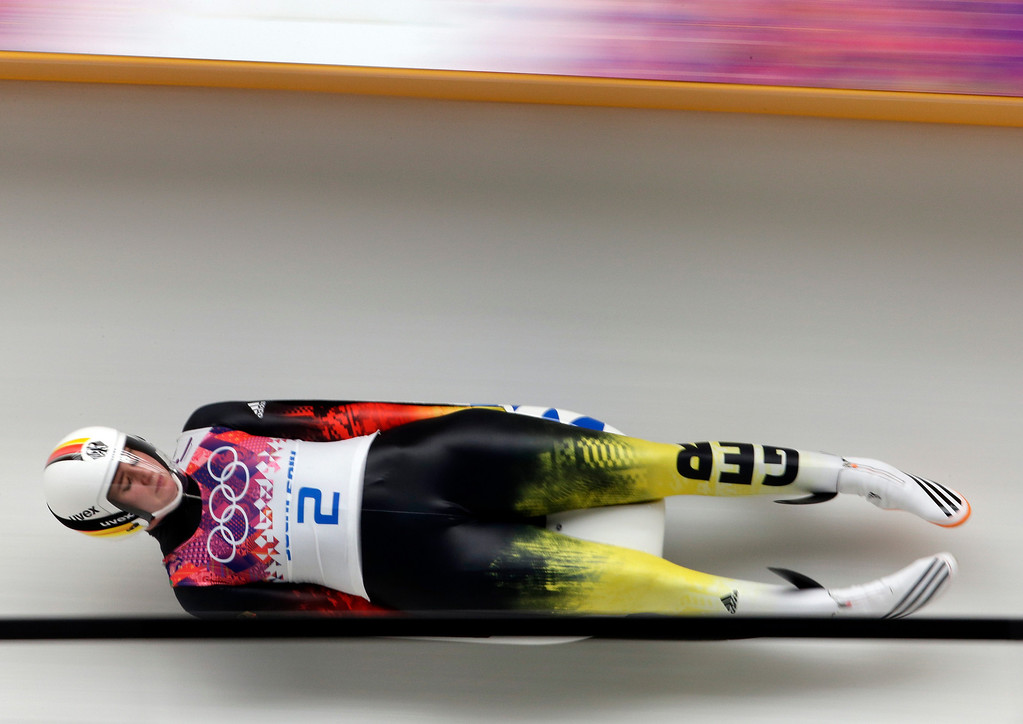 . Natalie Geisenberger of Germany speeds down the track in her second run during the women\'s singles luge competition at the 2014 Winter Olympics, Monday, Feb. 10, 2014, in Krasnaya Polyana, Russia. (AP Photo/Michael Sohn)