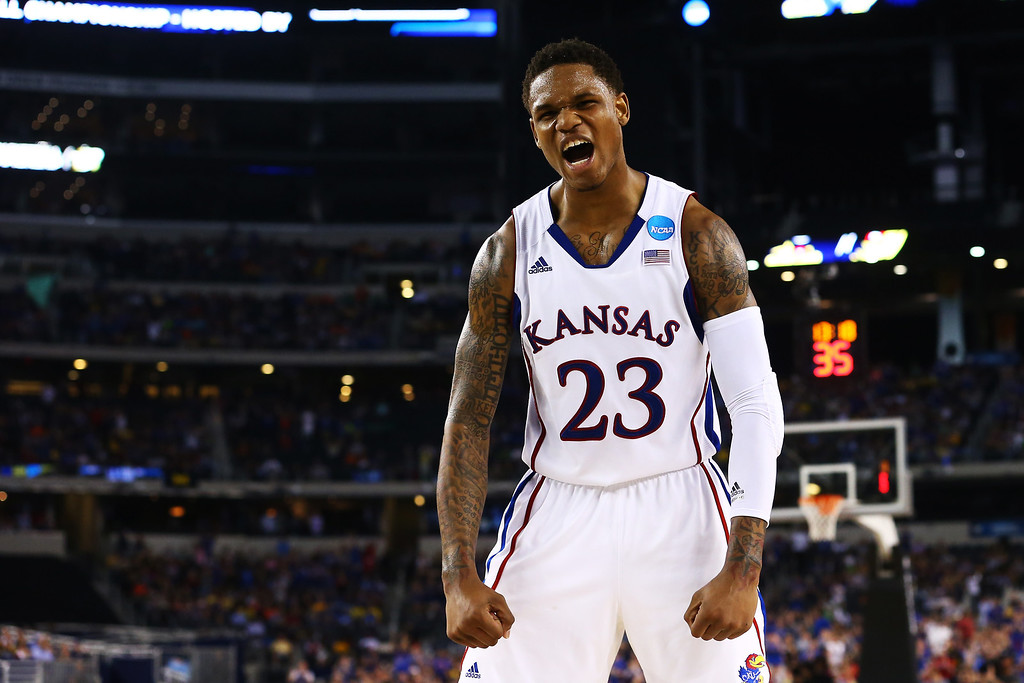 . ARLINGTON, TX - MARCH 29:  Ben McLemore #23 of the Kansas Jayhawks reacts in the second half against the Kansas Jayhawks during the South Regional Semifinal round of the 2013 NCAA Men\'s Basketball Tournament at Dallas Cowboys Stadium on March 29, 2013 in Arlington, Texas.  (Photo by Ronald Martinez/Getty Images)