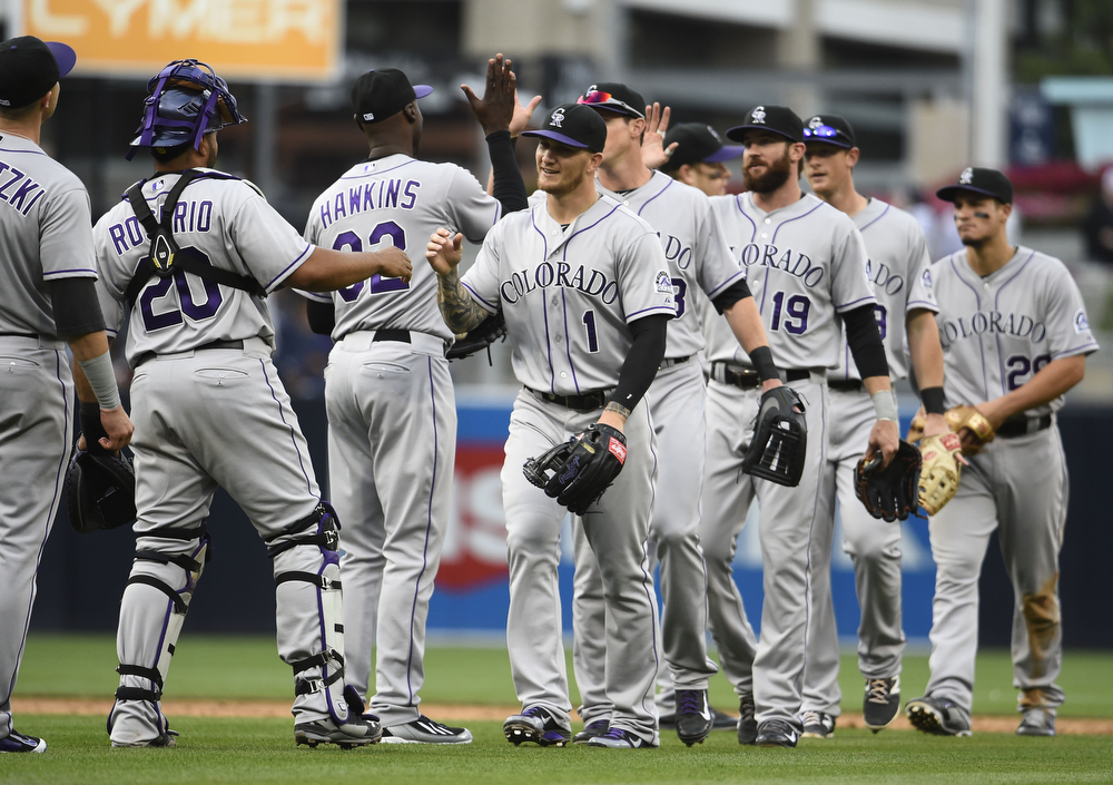 . Colorado Rockies players high-five after beating the San Diego Padres 3-1 in a baseball game at Petco Park April 17, 2014 in San Diego, California.  The Rockies won 3-1. (Photo by Denis Poroy/Getty Images)