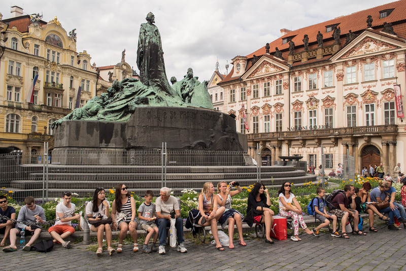 People resting under Jan Hus statue, Old Square, Prague